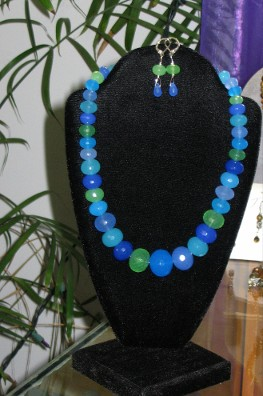 Faceted graduated multi-chalcedony in shades of green and blue with matching earrings.