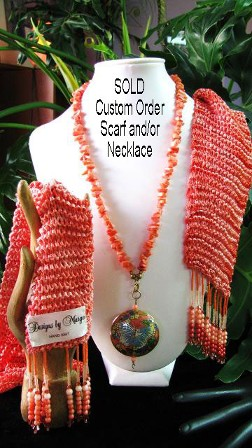 Designs By Marge handknitted, handbeaded scarf with swarovski crystals...peach and coral cloissonne' pendant